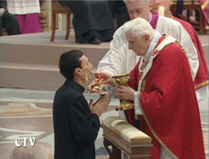 Pope Benedict gives Communion