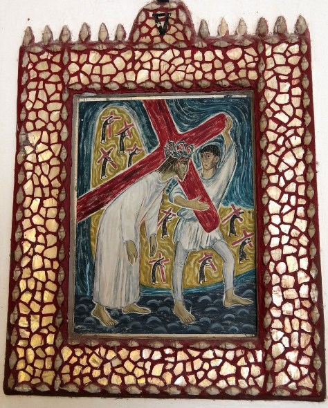 Simon of Cyrene takes up Jesus' Cross. From the Stations of the Cross at Sacred Heart church, Beagle Bay (Australia), painted in 1949 by a German Schoenstatt, Sister Roswina.